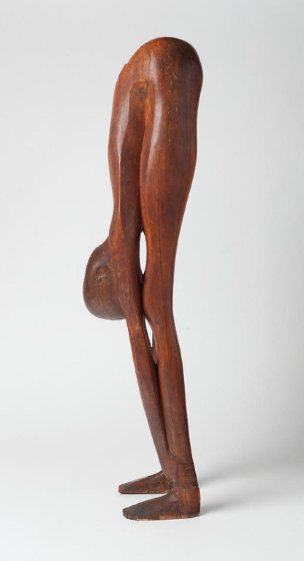Boy Looking through Legs, image 11