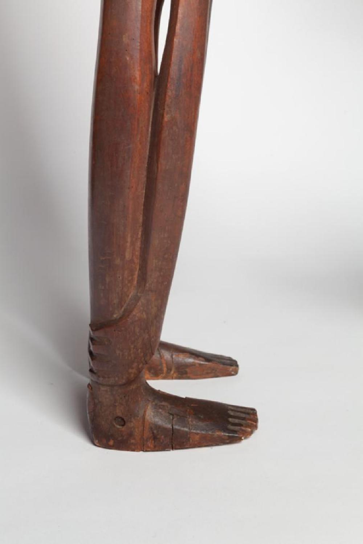 Boy Looking through Legs, image 7