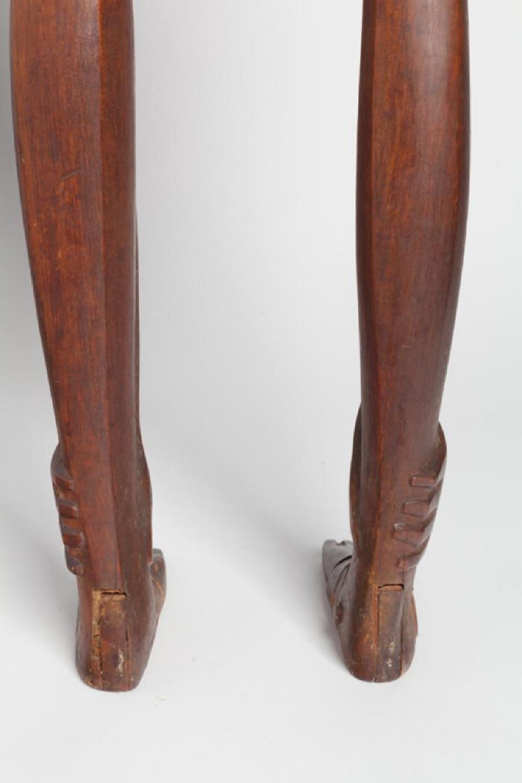 Boy Looking through Legs, image 5