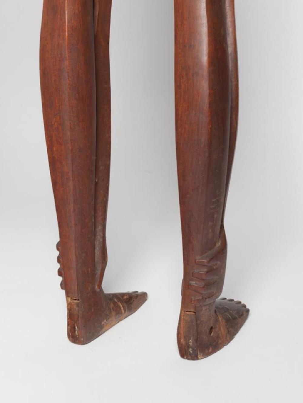 Boy Looking through Legs, image 4