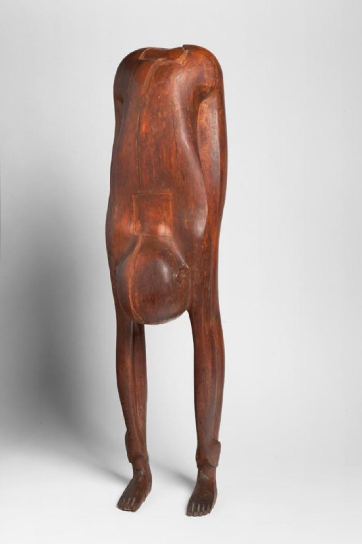 Boy Looking through Legs, image 12