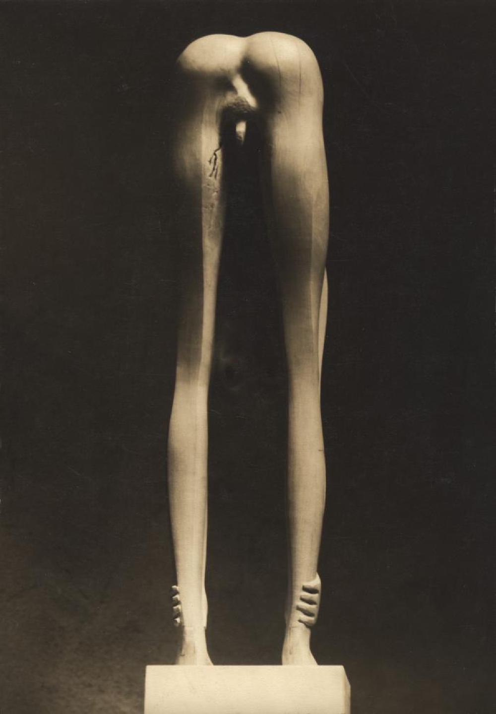 Boy Looking through Legs, image 3
