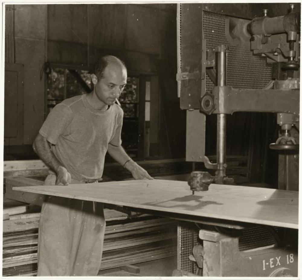 Isamu Noguchi working at a band saw in his MacDougal Alley Studio