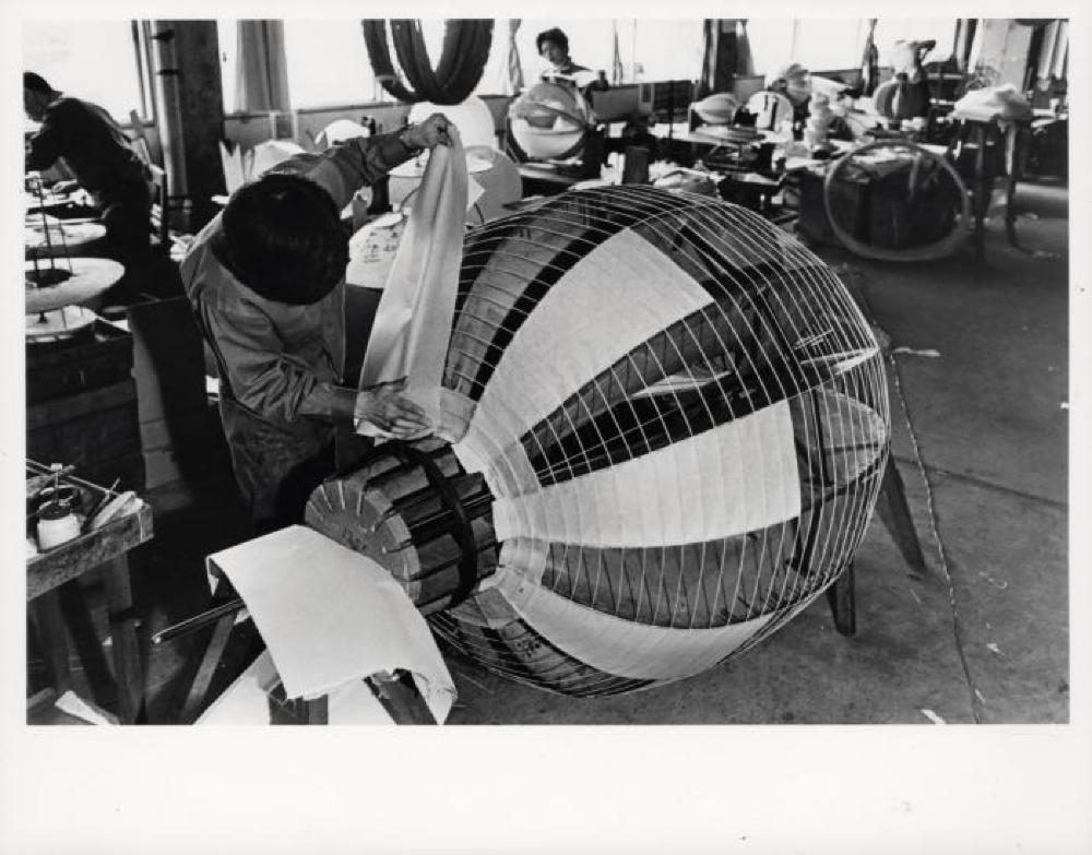 Worker at Ozeki Factory constructing Akari