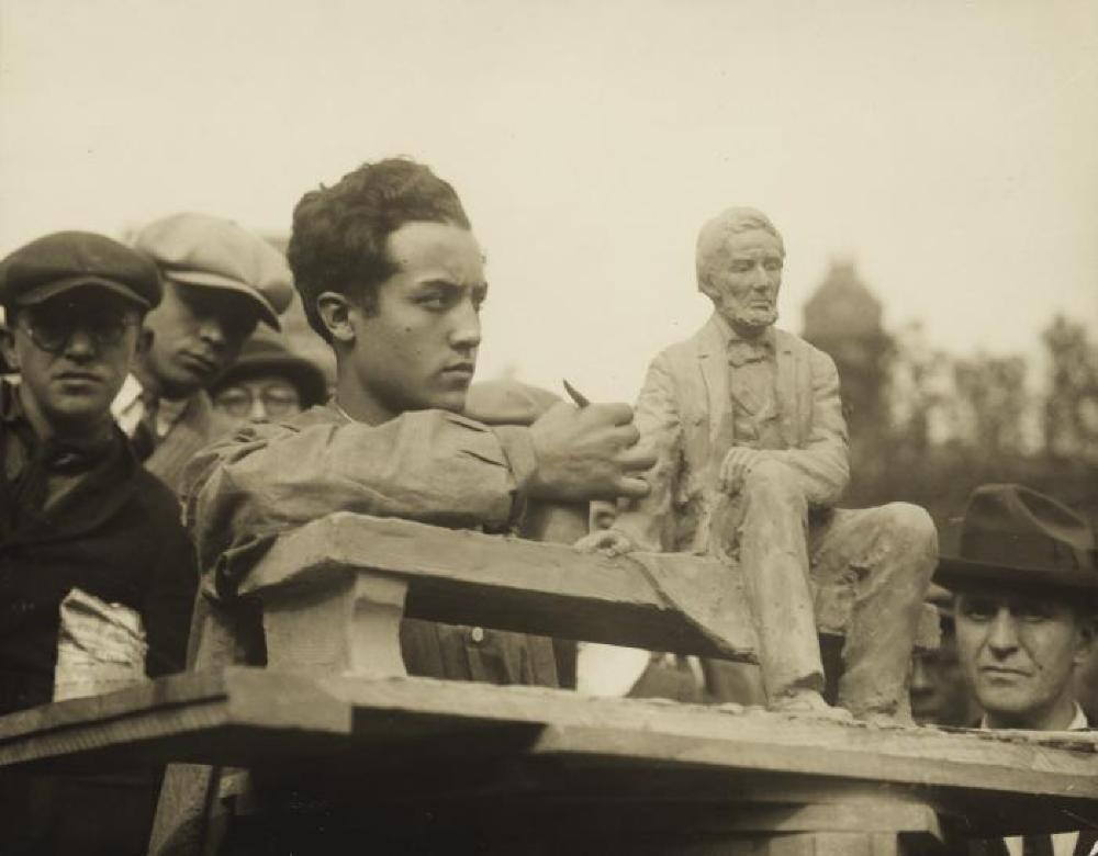 Isamu Noguchi at work on Study of Abe Lincoln