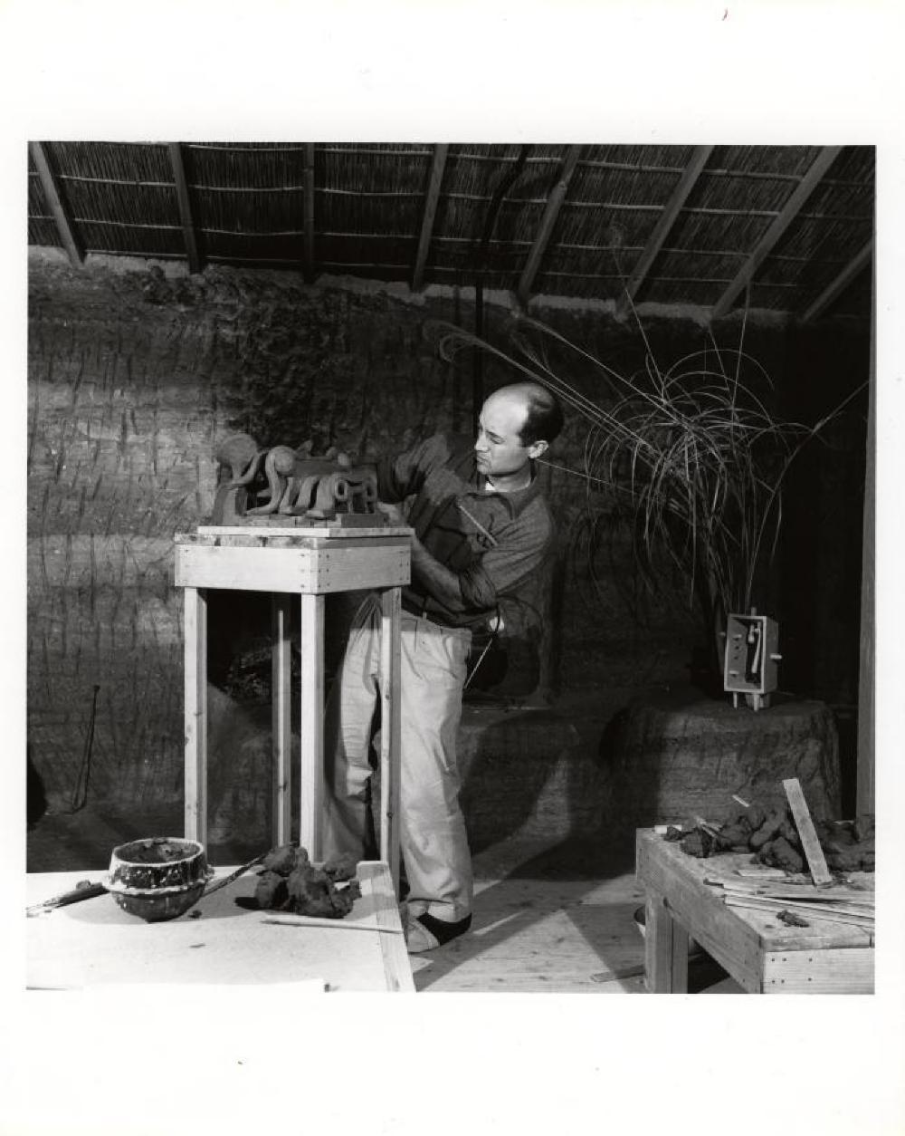 Isamu Noguchi working on ceramics at Kamakura Studio