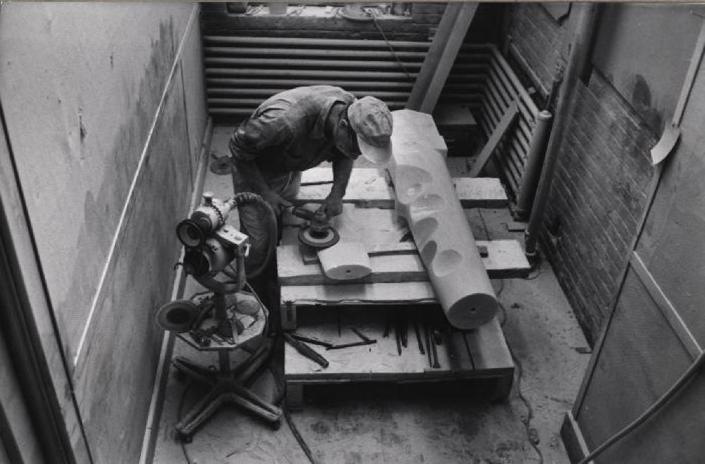 Isamu Noguchi working on Composition for Arrivals Building at Idlewild Airport at Edison Price Workshop