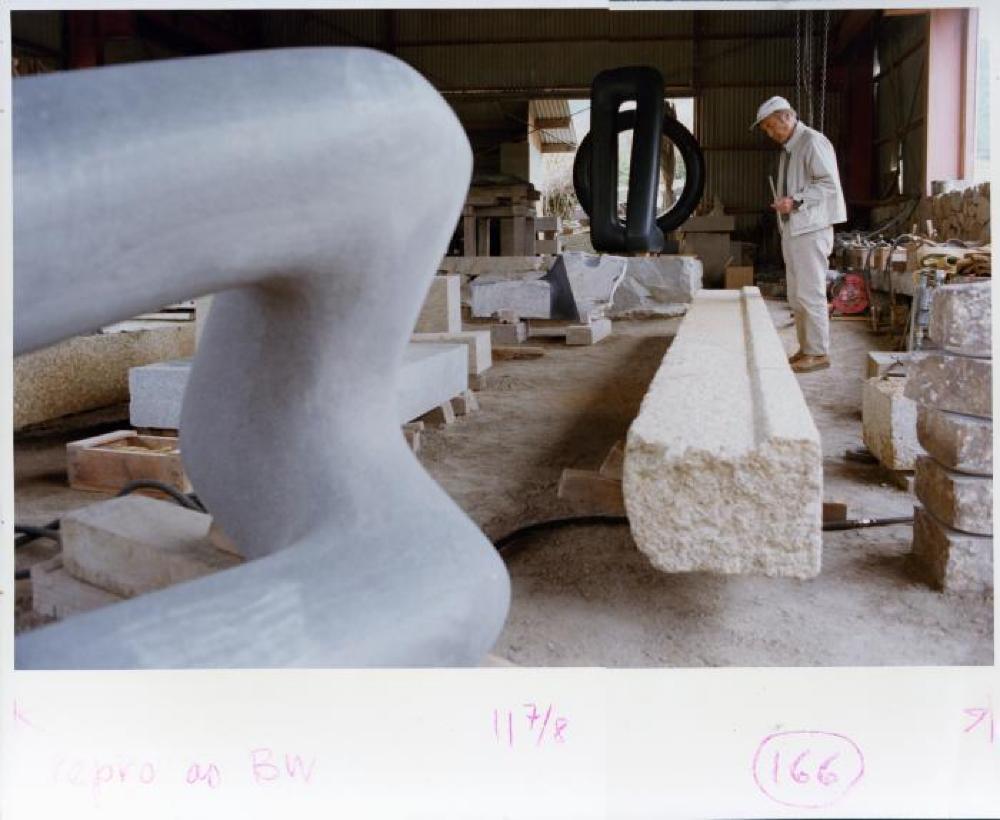 Isamu Noguchi working in Mure studio