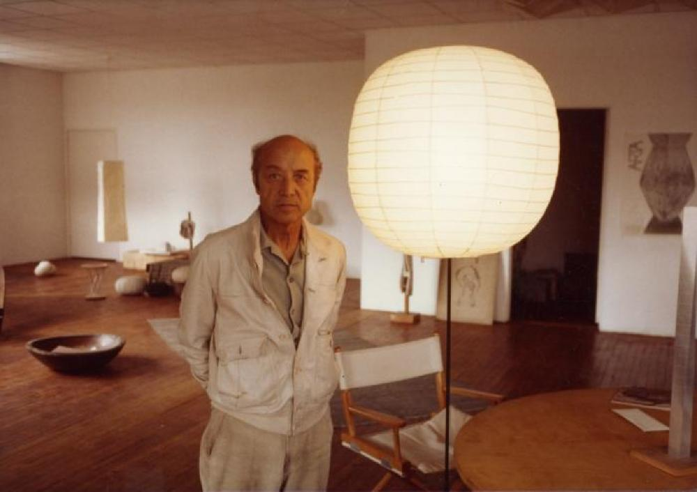Isamu Noguchi in Long Island City with his sculptures