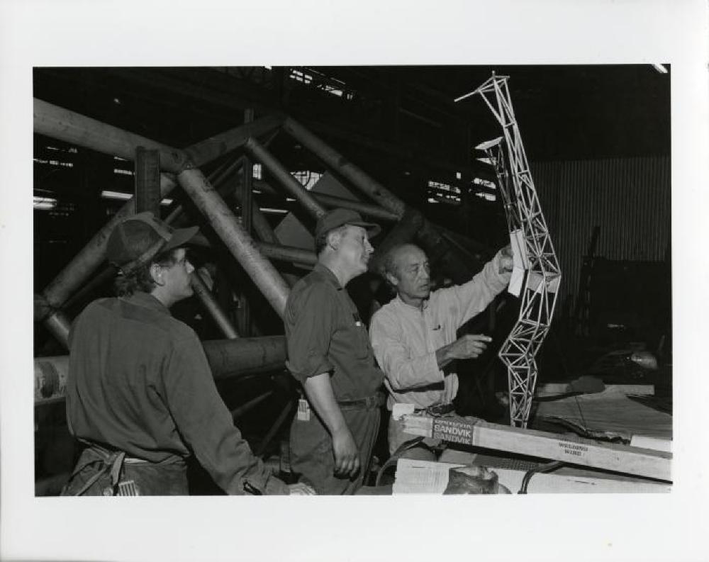 Isamu Noguchi at construction of Bolt of Lightening/Memorial to Ben Franklin