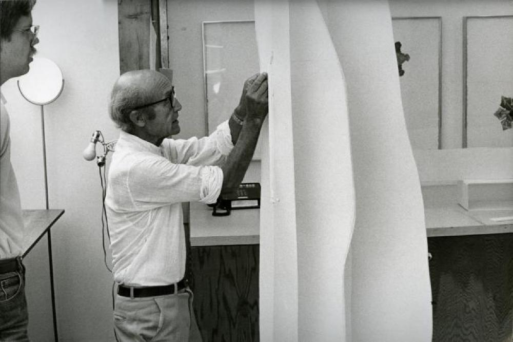 Isamu Noguchi working with Peter Carlson on prototype series of editioned sculptures for Gemini