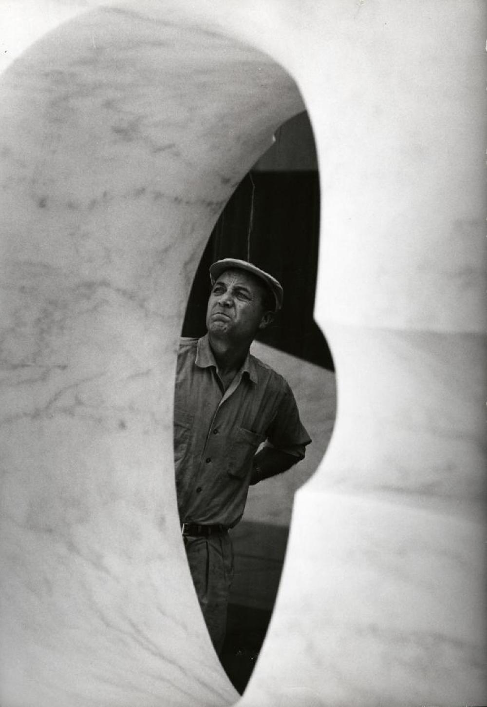 Isamu Noguchi working on marble element for the Sunken Garden at Beinecke Library, Yale