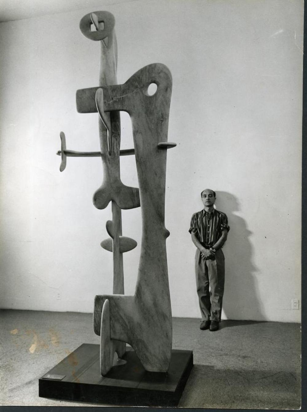 Isamu Noguchi with Kouros at Exhibition (Fourteen Americans)