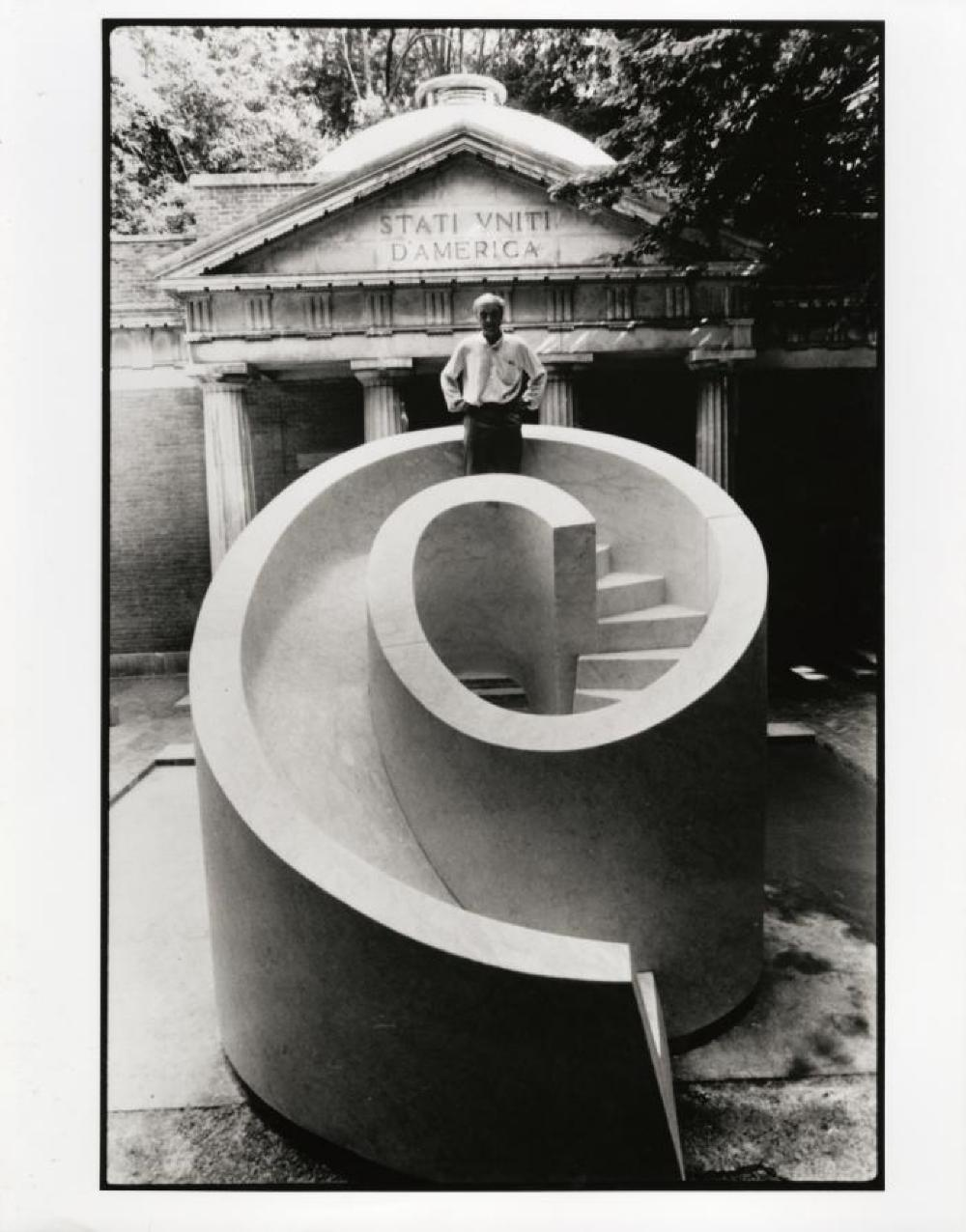 Isamu Noguchi in Venice, standing on top of Slide Mantra