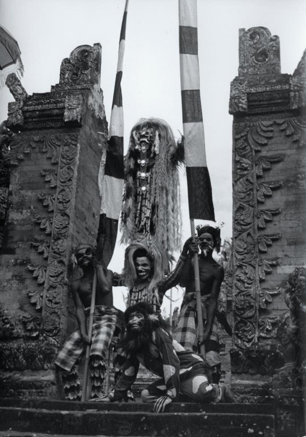 Bollingen travels: Barong performers with Candi bentar (split gate), Bali, Indonesia
