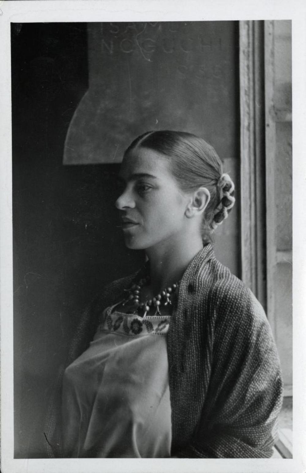 Portrait of Frida Kahlo at Noguchi's mural, History Mexico, in Mexico City