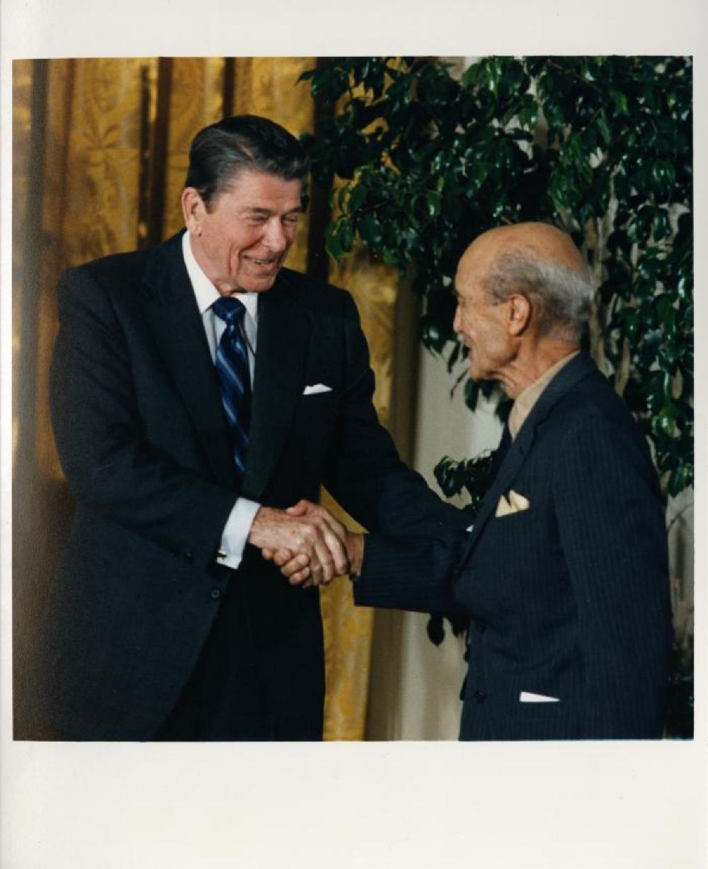 Isamu Noguchi receiving National Medal of Arts from Ronald Reagan
