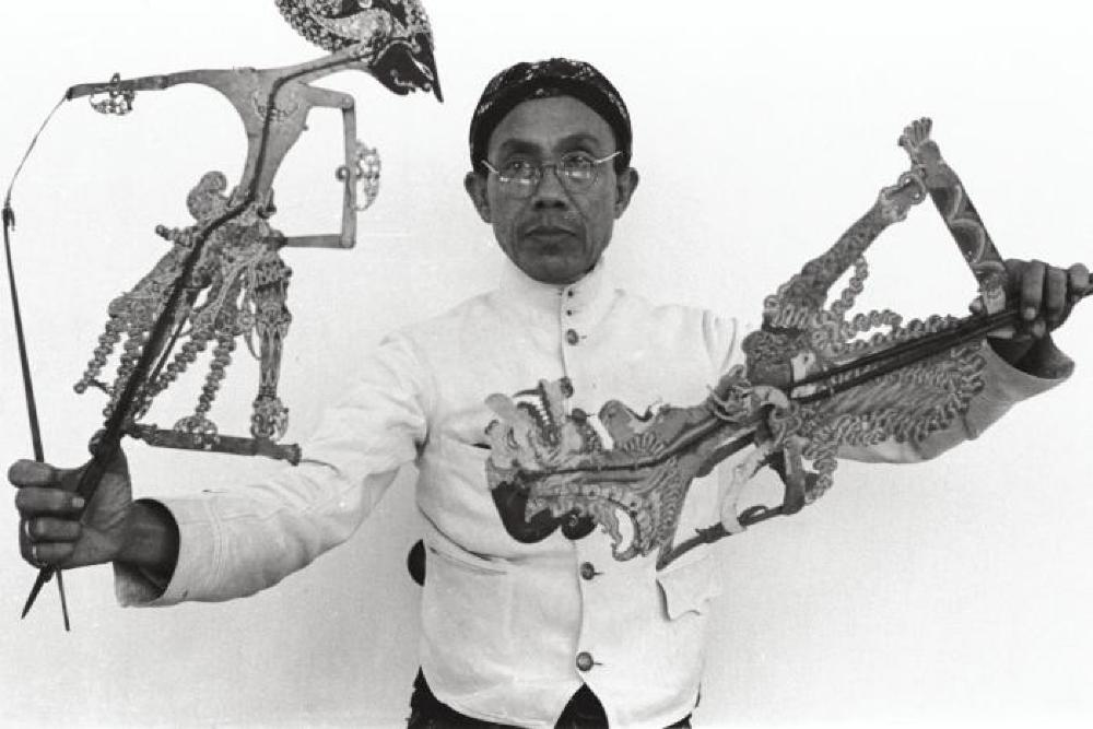 Bollingen Travels; Man with Wayang Kulit shadow puppets, Indonesia