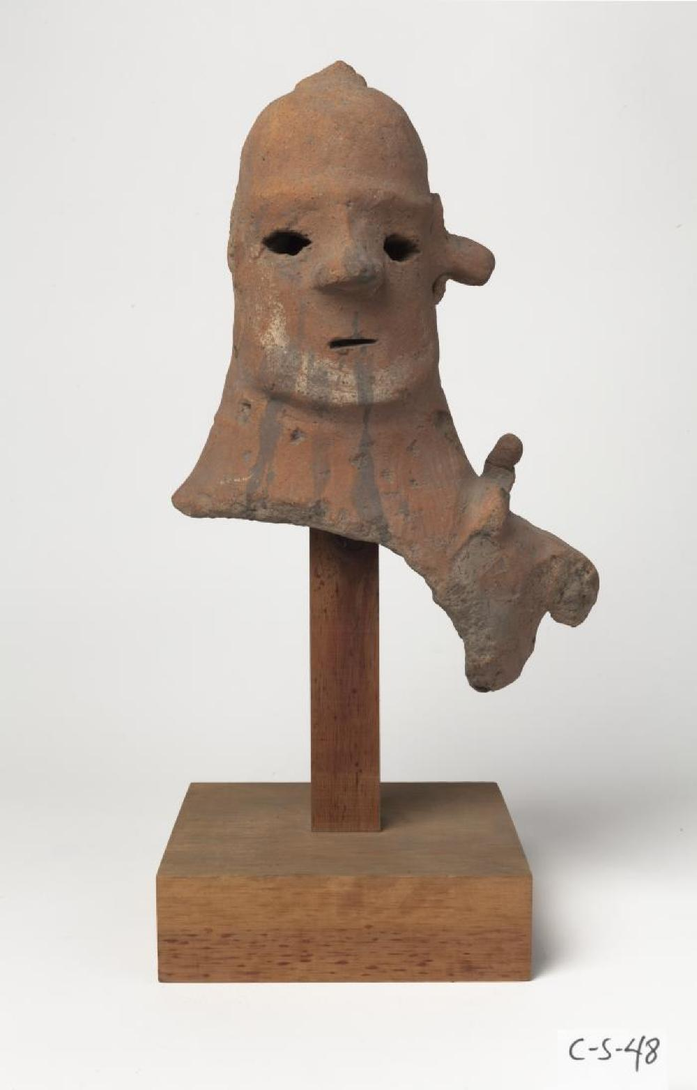 Japanese; Head of Haniwa Figure; Tumulus Period, 5th-6th century; Earthenware, wood base; 11 1/2 x 4 1/2 x 8 in., base 6 x 6 1/8 in.; Collection of Isamu Noguchi. (Study Collection; Collectibles, C-S-48)