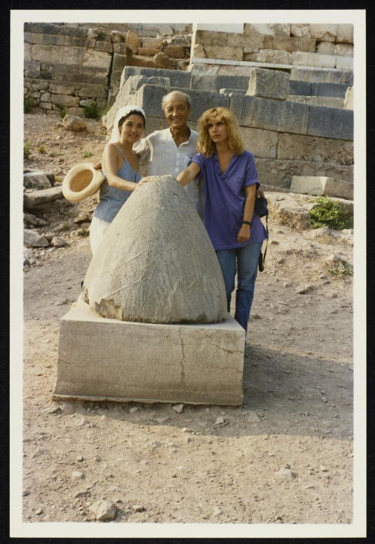 Isamu Noguchi, Kyoko Kawamura and Penny Bach with the Omphalos stone at Delphi, Greece