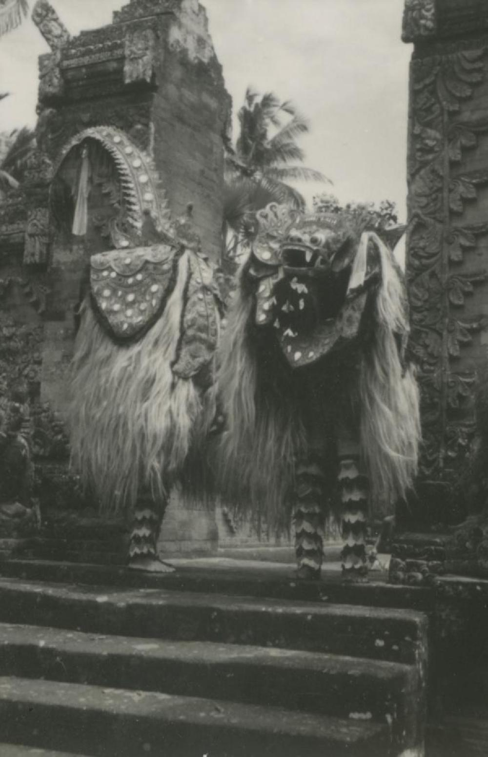 Bollingen Travels: Barong performers with Barong Ket mask at split gate in Bali, Indonesia